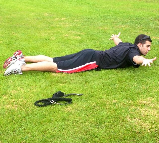 """Matt demonstrating how to do a """"T"""" exercise."""